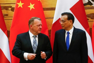 Denmark's Prime Minister Lars Lokke Rasmussen (L) recently made an official trip to China.