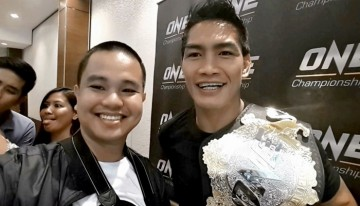 Conan Altatis poses with ONE lightweight world champion Eduard 'Landslide' Folayang during the Team Lakay Media Day on May 9, 2017 at Vikings Venue at SM Mall of Asia Bayside, Pasay City, Philippines.