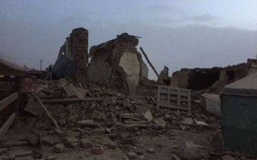 Scenes of ruined buildings and devastation littered a county in Western China following an earthquake on Thursday.