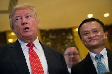 Alibaba founder Jack Ma (R) is facing criticism from Capitol Hill for the acquisition of MoneyGram by Ant Financial, an Alibaba subsidiary.