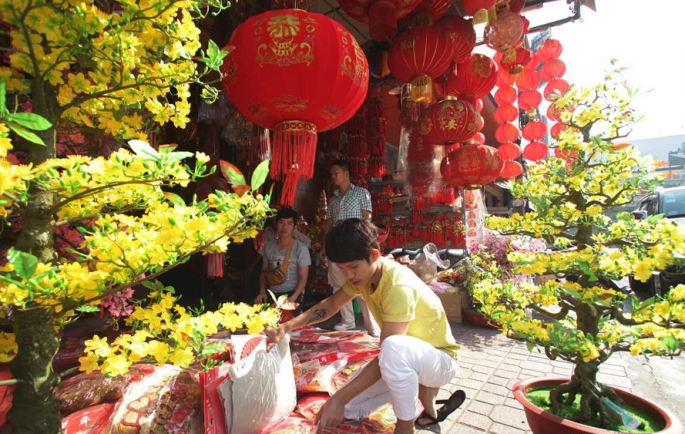 A seller prepares decorations for the Chinese New Year at a shop in Phnom Penh