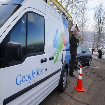A technician gets cabling out of his truck to install Google Fiber in a residential home in Provo, Utah.