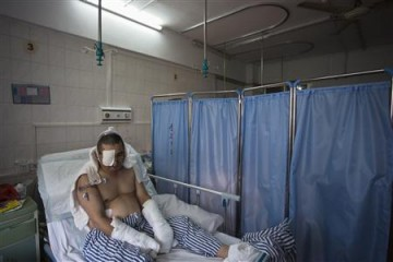A patient waiting for an operation at a hospital in southern China.