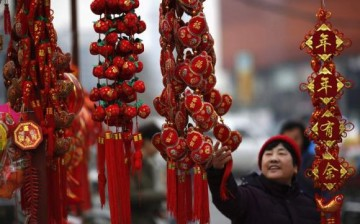 A woman looks at Chinese Lunar New Year decorations.