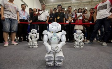 Robots made by students of Wuhan Institute of Technology University during an electronics expo in Wuhan, Hubei Province.
