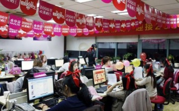 Employees processing orders on Tmall.