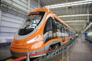 A newly manufactured tram powered by hydrogen fuel cells is presented at Qingdao.