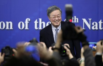 China's central bank governor Zhou Xiaochuan arrives at a news conference during the annual session of the National People's Congress (NPC), the country's parliament, in Beijing, March 12, 2015.