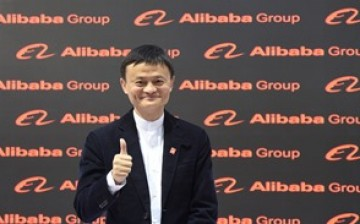 Alibaba chairman Jack Ma poses before the media during the CeBIT trade fair in Hanover.