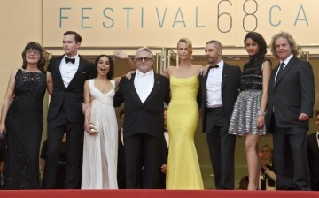 Margaret Sixel (L), Nicholas Hoult, Zoe Kravitz, George Miller, Charlize Theron, Tom Hardy, Courtney Eaton and Doug Mitchell pose as they arrive for the screening of