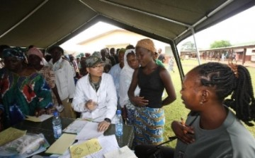 A doctor belonging to the Chinese medical team attends to patients in an African town.