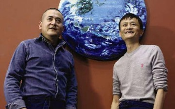 Zeng Fanzhi and Jack Ma pose with their oil painting entitled