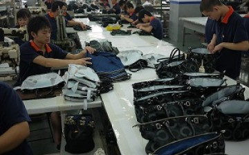 Workers make the final check on products made by a factory in Dongguan, China's manufacturing hub.
