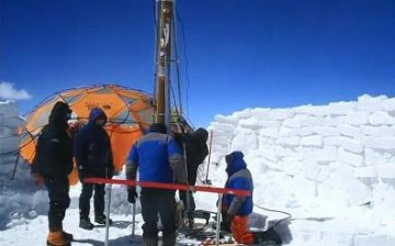 Scientists dig ice cores in the Qinghai-Tibetan Plateau to study climate change.