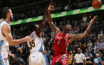 Houston Rockets power forward Terrence Jones (R) battles Denver Nuggets' Kenneth Faried for the rebound. Jones is the subject of many recent NBA trade rumors, including links to the Suns and Pelicans.
