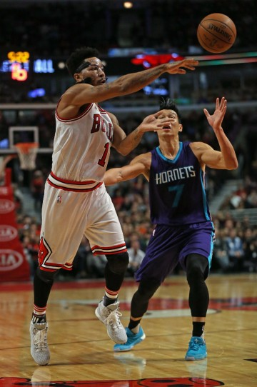 Charlotte Hornets point guard Jeremy Lin defends against Chicago Bulls' Derrick Rose.