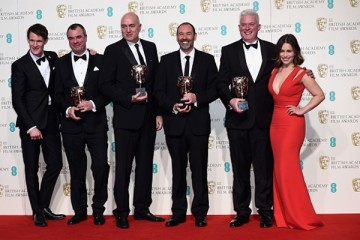 Matt Smith and Emilia Clarke pose with Chris Corbould, Roger Guyett, Paul Kavanagh and Neal Scanlan, winners of the Visual Effects award for 'Star Wars: The Force Awakens' at the EE British Academy Film Awards.