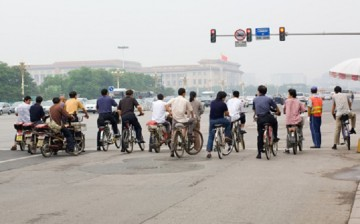 Two wheels will do: Traditional bikes, motorcycles and electronic bikes or e-bikes continue to be a favorite mode of transportation in China.