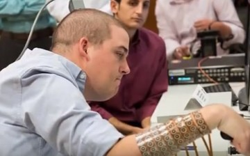 A chip implanted in the brain has allowed Ian Burkhart who has been paralyzed from three years  to move his fingers, wrist and hand again.
