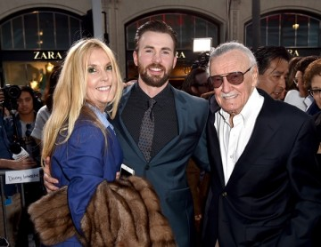 Stan Lee poses for a photo with actor Chris Evans at the premiere of