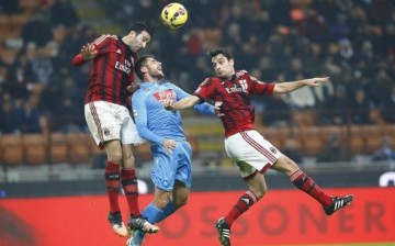 AC Milan players (in red) engaged an opponent in a play at the San Siro Stadium in Milan in Dec. 2014.