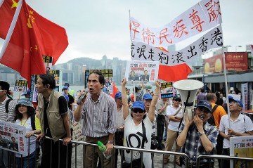 Hong Kongers Stage Satirical Rally Urging Mainland Chinese To Stay At Home