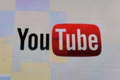 The YouTube logo appears on screen at the 2012 International Consumer Electronics Show at the Las Vegas Hotel & Casino on January 12, 2012.