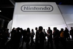 Crowds line up to view the new Nintendo game console Wii U, not the Nintendo NX