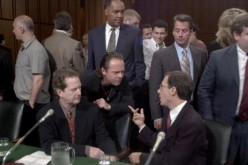 Roger McGuinn, a member of The Byrds, seated left, Lars Ulrich of Metallica center, Hank Barry CEO Napster seated right, share words before the Senate Judiciary Committee July 11, 2000, in Washington, DC where they testified on musical copyright and the I