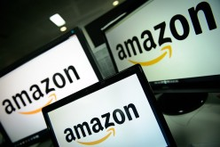 A picture shows the logo of the online retailer Amazon dispalyed on computer screens in London on December 11, 2014.