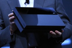 Andrew House, President and Group CEO Sony Computer Entertainment Inc., holds up a Playstation 4, not the PlayStation NEO
