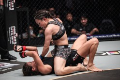 GIRL FIGHT | Mei Yamaguchi (top) rains down heavy strikes on Angela Lee in the main event of ONE: ASCENT TO POWER