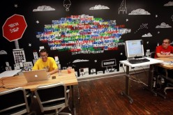 Employees of Google work at a 'tech stop' at the internet company's new office space