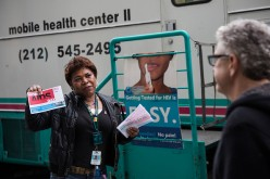 An HIV Prevention Specialist solicits people on the street to take a free HIV test.