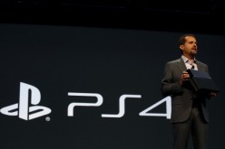 Andrew House, President and Group CEO Sony Computer Entertainment Inc., holds up a Playstation 4, not the PlayStation NEO 4K