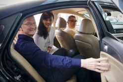 Tim Cook rides a cab with Didi Chuxing President Jean Liu.