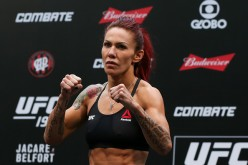 Cris 'Cyborg' Justino is posing in front of the crowd at the UFC 198 weigh-ins.
