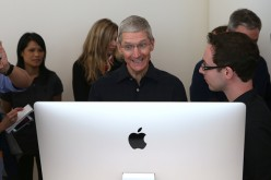 Apple CEO Tim Cook looks at the new 27 inch iMac with 5K retina display during an Apple special event