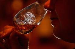Andrew Kirk, a malt advocate, noses a glass of whisky
