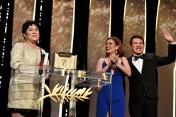Jaclyn Jose reacts on stage as Andi Eigenmann and director Brillante Mendoza applaud after being awarded the Best Actress prize during the closing ceremony of the annual 69th Cannes Film Festival.