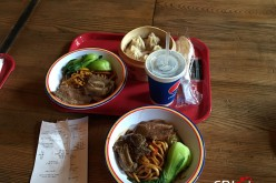 Photo taken on May 20, 2016 shows two bowls of noodles, one cup of coke and one basket of pork buns which cost 180 yuan ($28) at the Shanghai Disney Resort.