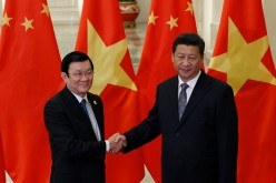 Vietnam's President Truong Tan Sang shakes hands with China's President Xi Jinping on the sidelines of the Asia Pacific Economic Cooperation (APEC) meetings, Nov. 10, 2014 in Beijing, China.