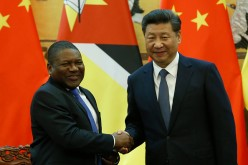 President Xi Jinping shakes hands with Mozambique President Filipe Jacinto Nyusi during a meeting on Wednesday.