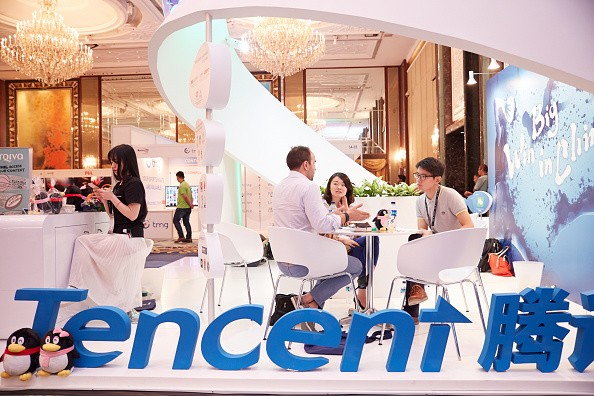 Visitors and exhibitors network at the Tencent booth during the Sportel Asia Conference on March 15, 2016 in Singapore.