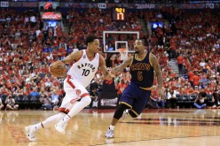 Toronto Raptors' DeMar DeRozan drives against Cleveland Cavaliers' J.R. Smith in the third quarter in Game 6 of the Eastern Conference Finals during the 2016 NBA Playoffs at Air Canada Centre.
