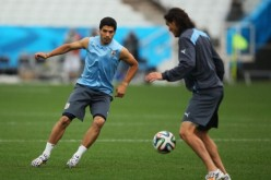 Uruguay strikers Luis Suárez (L) and Edinson Cavani.