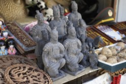 Some miniature sculptures of the famous Terracotta warriors get sold in a market in China along with other interesting souvenir items.