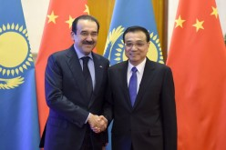 Chinese Premier Li Keqiang (right) welcoming Kazakhstan Prime Minister Karim Massimov during the latter's state visit.