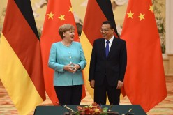 Chinese Premier Li Keqiang holds a joint press conference with German Chancellor Angela Merkel in Beijing.