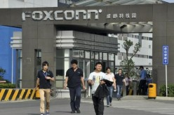 Workers walk away from a Foxconn factory in Chengdu, Sichuan Province.